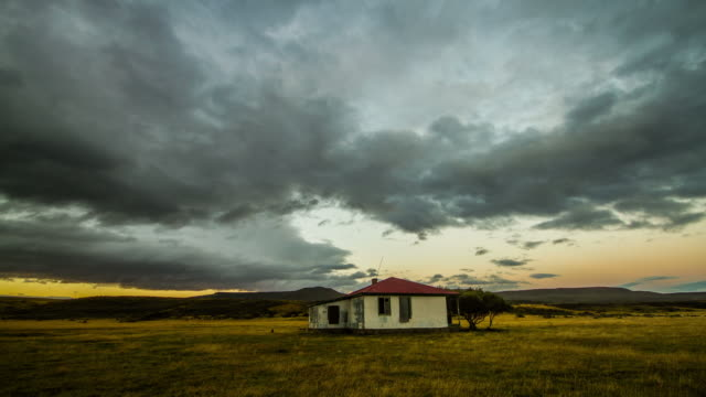 clouds moving over house in patagonia in southern chile - isolamento video stock e b–roll