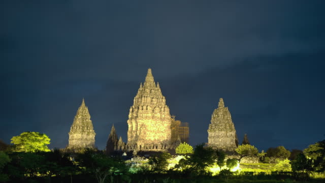 T/L WS Clouds moving over illuminated Prambanan Temple complex at night/ Yogyakarta, Indonesia