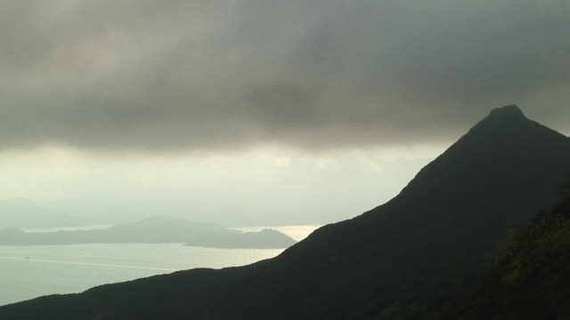 stockvideo's en b-roll-footage met ms clouds moving over mountain, hong kong, china - hong kong