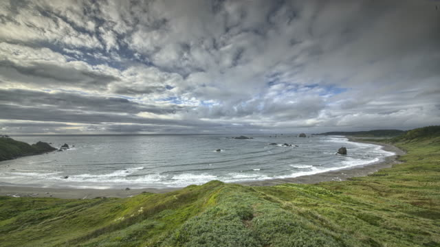 clouds moving over pacific ocean - high dynamic range imaging stock videos and b-roll footage