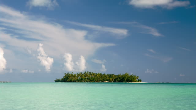 tl ws clouds moving over palm tree-covered island/ bora bora, tahiti  - bora bora stock videos & royalty-free footage