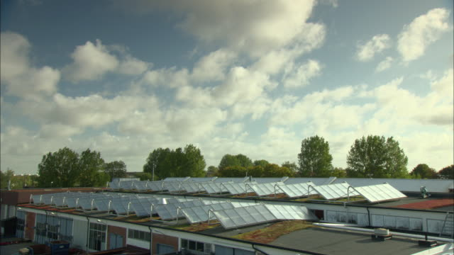 WS HA Clouds moving over rooftops with rows of solar panels / Malmo, Sweden