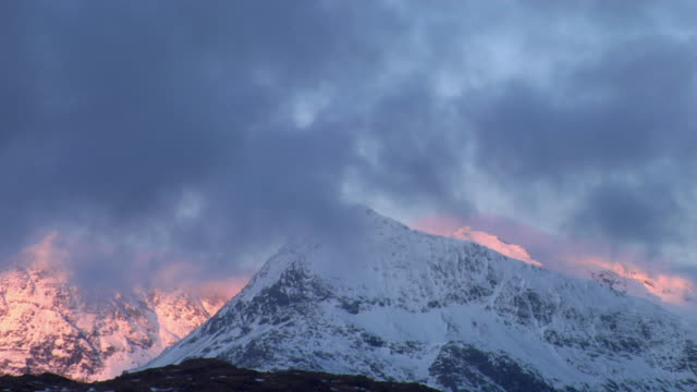 ms clouds moving over snowcapped mountains at dawn / capel curig, snowdonia, uk - snowdonia stock videos & royalty-free footage