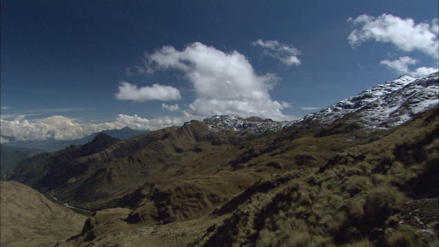 T/L WS Clouds moving over snowcapped mountains / Cuzco Region, Peru