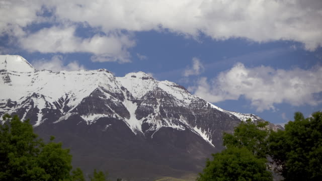 t/l ws pan clouds moving over snowcapped peak / orem, utah, usa - orem utah stock videos & royalty-free footage