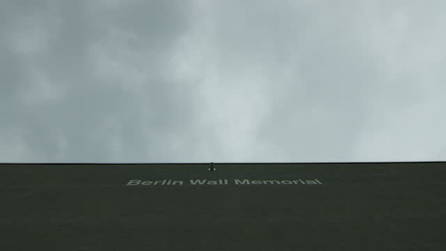 clouds moving over the berlin wall / berlin, germany - symbols of peace stock videos & royalty-free footage
