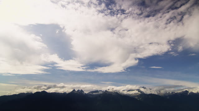 WS T/L Clouds moving over Whistler mountains / Squamish, British Columbia, Canada