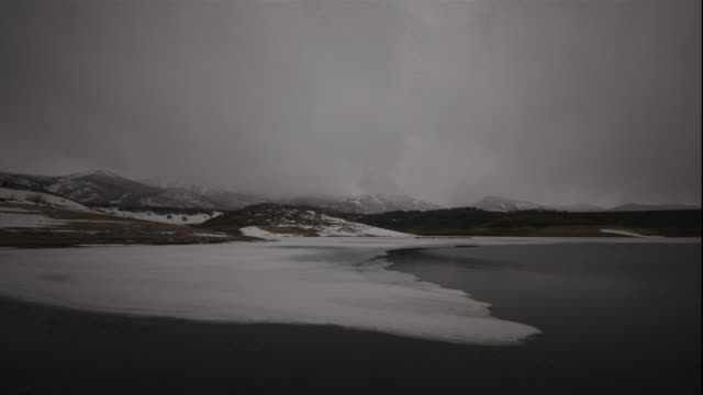ws pan t/l clouds moving rapidly above icy lake in deer creek reservoir  / provo, utah, usa - provo stock videos & royalty-free footage