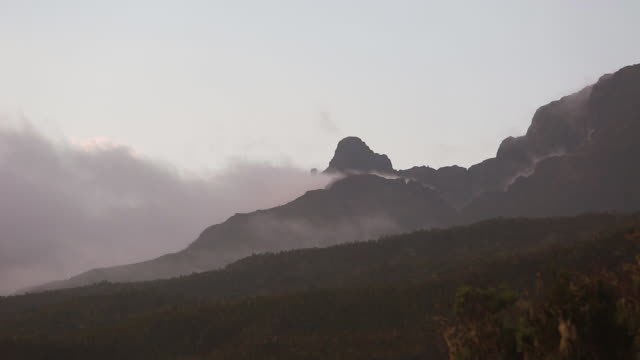 clouds moving slowly around mountain & valley - wiese stock videos & royalty-free footage