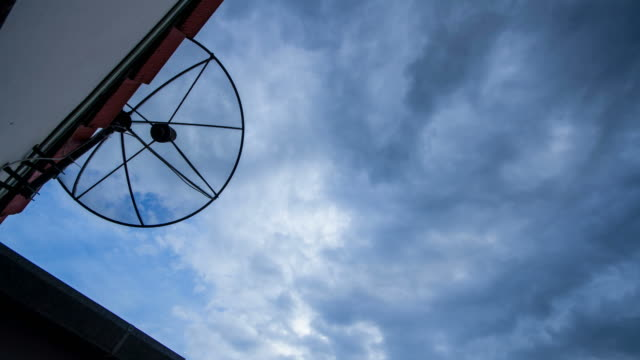 4k t/l clouds moving the satellite dish in thailand - satellite tv stock videos and b-roll footage