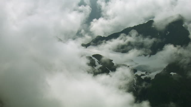 clouds obscure glacier in alaska - cold temperature stock videos & royalty-free footage