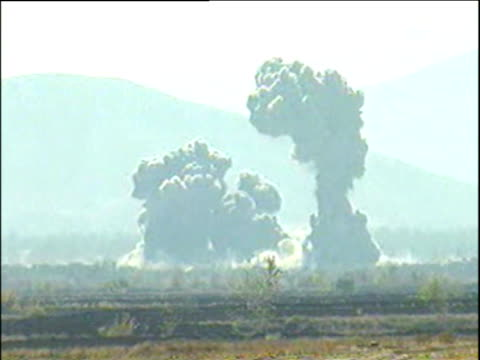 Clouds of smoke from bombs dropped on Taliban land by American B52s War in Afghanistan 2001