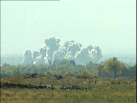 vidéos et rushes de clouds of smoke from bombs dropped on taliban land by us b52s war in afghanistan - guerre d'afghanistan : de 2001 à nos jours
