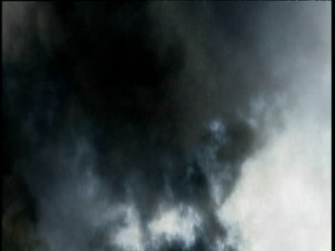 Clouds of smoke swirl into sky following explosion
