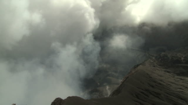 Clouds of volcanic gas rise from giant crater at Marum volcano, Ambrym Island, Vanuatu