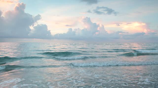 clouds on horizon at sunrise over ocean - eskapismus stock-videos und b-roll-filmmaterial