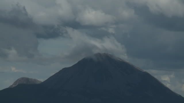 clouds on top of mountain peak - rauchartig stock-videos und b-roll-filmmaterial