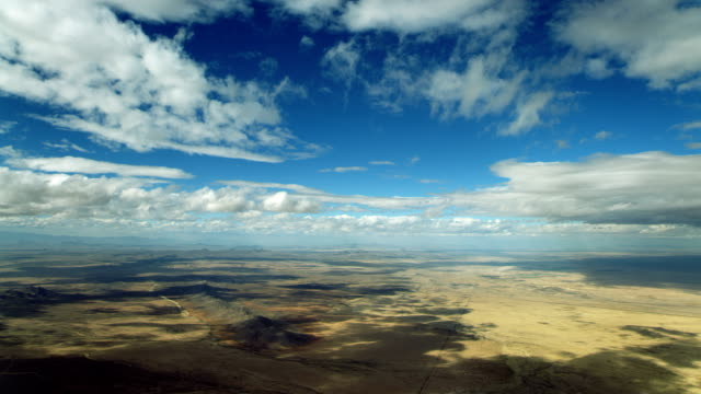 clouds over arid new mexico landscape - clip stock videos & royalty-free footage