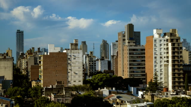 clouds over city timelapse - argentina stock videos & royalty-free footage