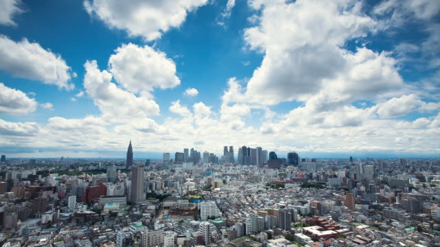t/l ws clouds over city / tokyo, japan - tokyo japan stock videos and b-roll footage