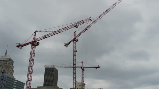 WS T/L Clouds over cranes and tower in construction site / Oklahoma city, Oklahoma, USA