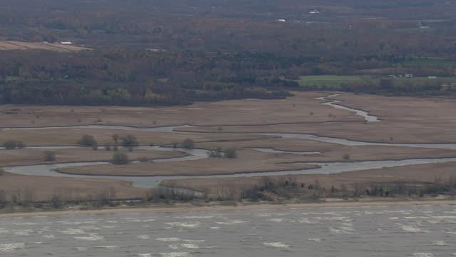 ws aerial pan clouds over edge of lake ontario / new york, united states - lake ontario bildbanksvideor och videomaterial från bakom kulisserna