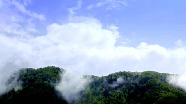 hd: clouds over hill - evaporation stock videos & royalty-free footage