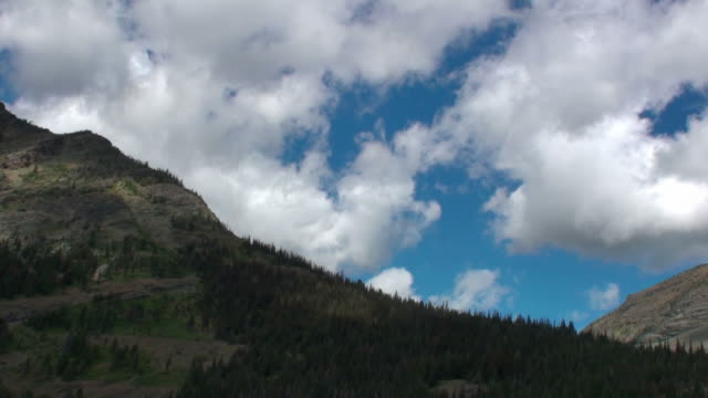 clouds over mountain timelapse - glacier national park us stock videos and b-roll footage