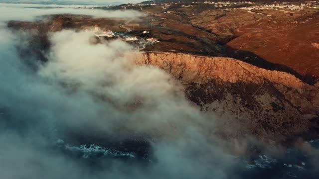 clouds over ocean at cabo da roca lighthouse - roca video stock e b–roll