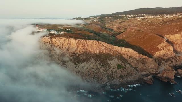 clouds over ocean at cabo da roca lighthouse - roca点の映像素材/bロール