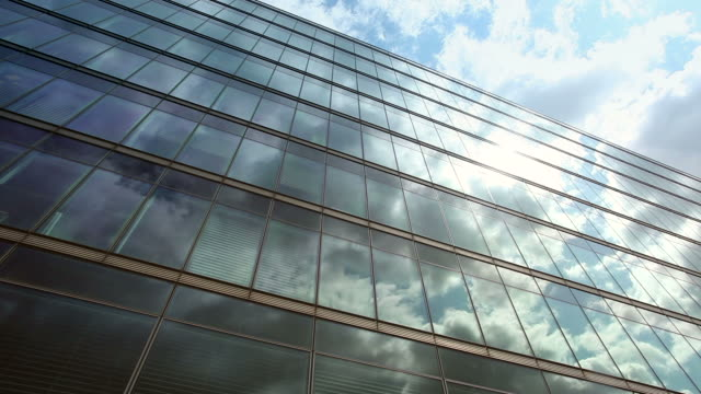 clouds over office windows - office block exterior stock videos & royalty-free footage