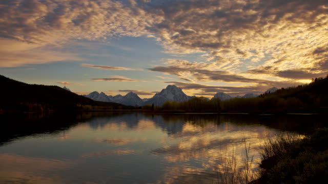 TIME LAPSE WIDE SHOT clouds over Oxbow Bend on Snake River with snowy Tetons in background, Grand Teton National Park, Wyoming