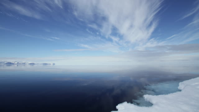t/l ws clouds over sea, snow in foreground / pond inlet, nunavut, canada - nu stock videos & royalty-free footage