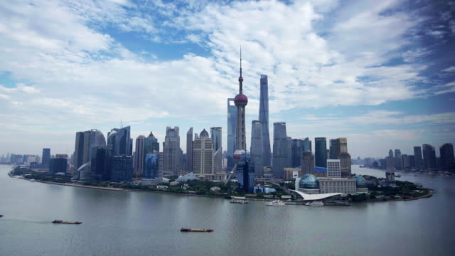 ws tl clouds over shanghai skyline, china - river huangpu stock videos & royalty-free footage