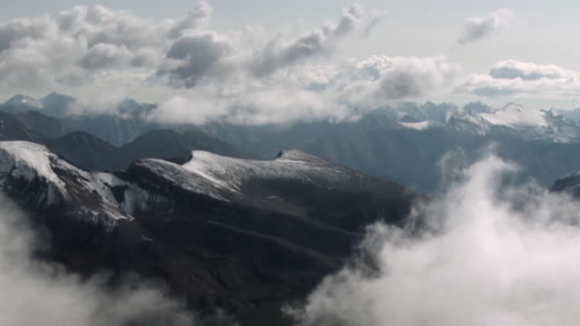 stockvideo's en b-roll-footage met aerial clouds over snow covered canadian rockies mountains, jasper national park, alberta, canada - jasper national park