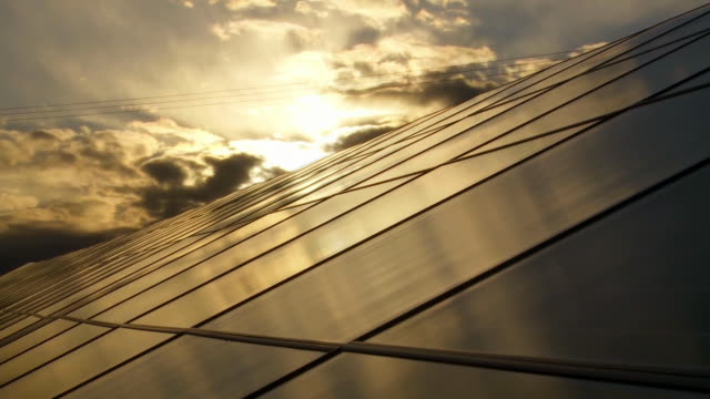 clouds over solar power station cinemagraph - solar panel stock videos & royalty-free footage