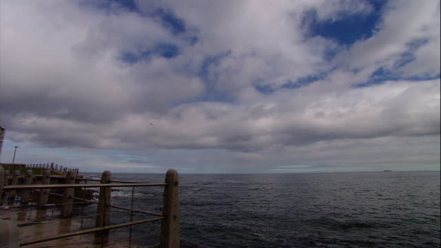 clouds pass over an ocean pier. - pier stock videos & royalty-free footage
