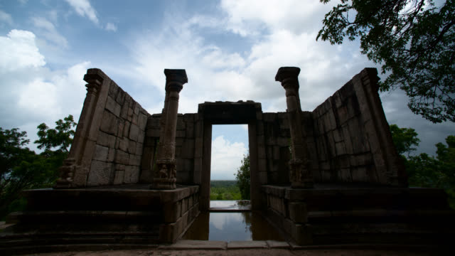 clouds pass over doorway at yapahuwa, sri lanka. - sri lankan culture stock videos & royalty-free footage
