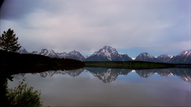 clouds pass over jackson lake at grand teton national park. - mt moran stock videos & royalty-free footage