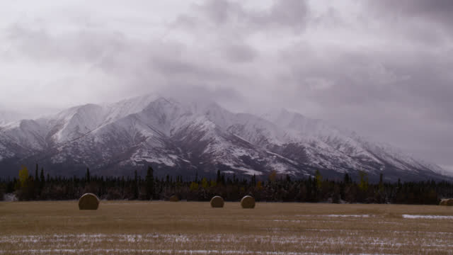 clouds pass over mountain, alaska. - mountain range stock videos & royalty-free footage