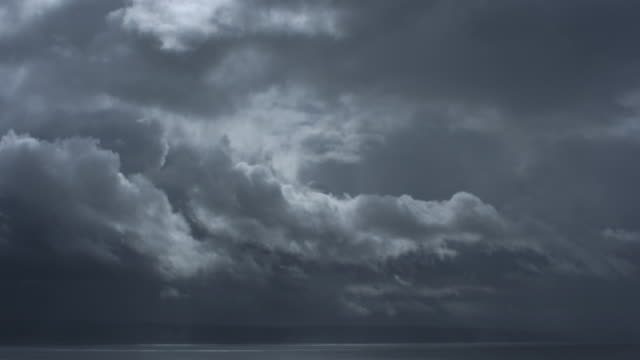 clouds pass over ocean. - storm cloud stock videos & royalty-free footage