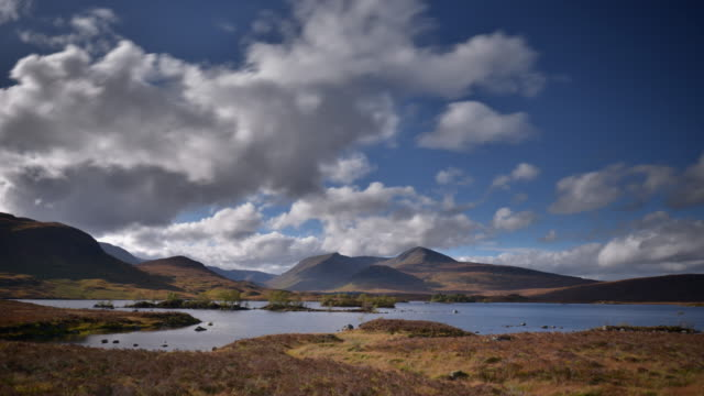 Clouds pass overhead and are reflected in the water of Rannoch Moor in the Highlands of Scotland
