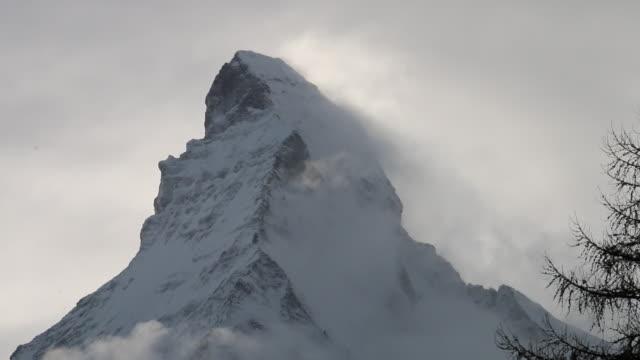 Clouds pass summit of Matterhorn, after fresh snowfall