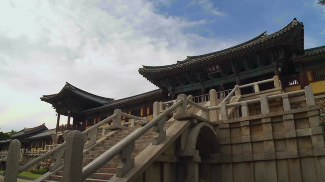t/l clouds passing above and tourists visiting bulguksa temple / gyeongju, kyungsangnamdo, south korea - gyeongju stock videos & royalty-free footage