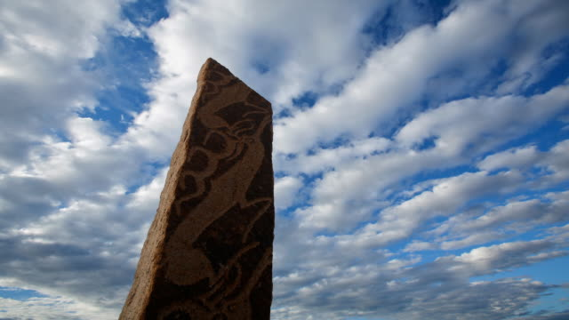 T/L, WS, clouds passing ancient deer stones near Moron / Khovsgol, Mongolia