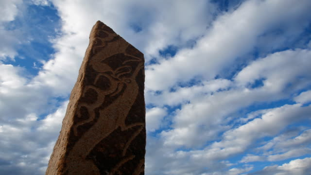 T/L, WS, ZO, clouds passing ancient deer stones near Moron / Khovsgol, Mongolia