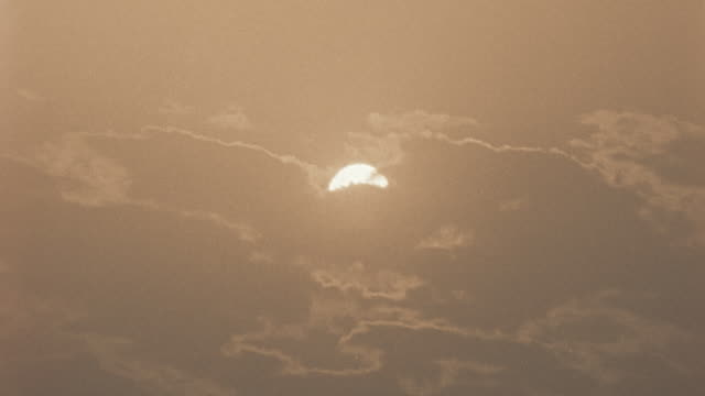 la ws clouds passing in front of sun / egypt - in front of stock videos & royalty-free footage