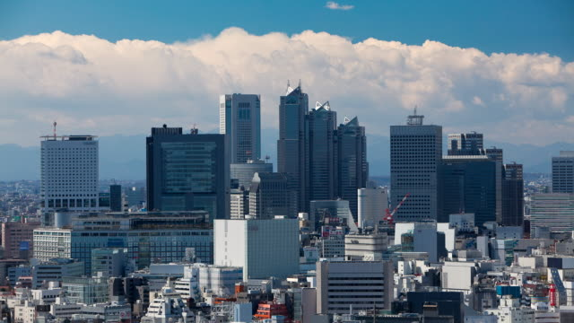 T/L WS Clouds passing over business and shopping district / Tokyo, Japan