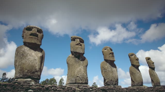 T/L WS LA Clouds passing over Moai figures / Ahu Akivi, Easter Island, Chile