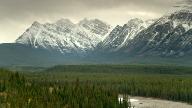 WS T/L ZO Clouds passing over Mt. Fryatt and Athabasca River/ Jasper National Park, Alberta, Canada